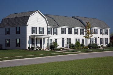Barn-style townhouses with private front and back entrances.