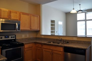 Every villa kitchen features granite counters, stainless appliances, and undermount sinks.