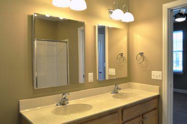 Dual vanity sinks and medicine cabinet in the villa master bath.