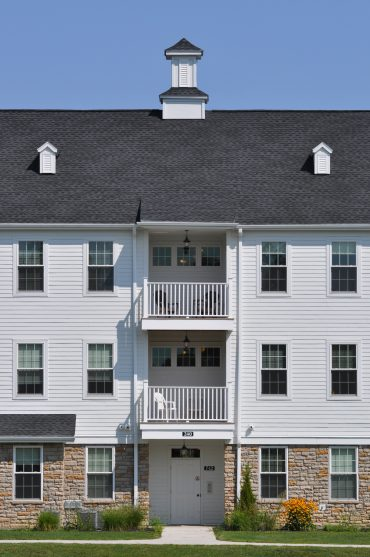 View of 2 bedroom apartment balconies in the Phase III White Gable Mansions.