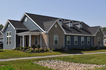 The villas feature 2 bedrooms, single-story living, and attached garages.
