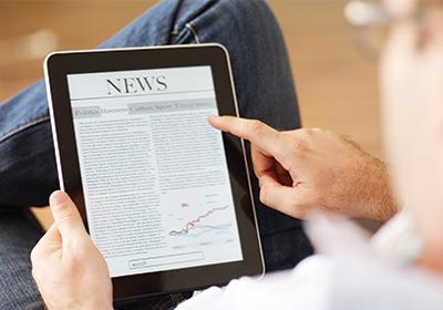 Man reads news on iPad
