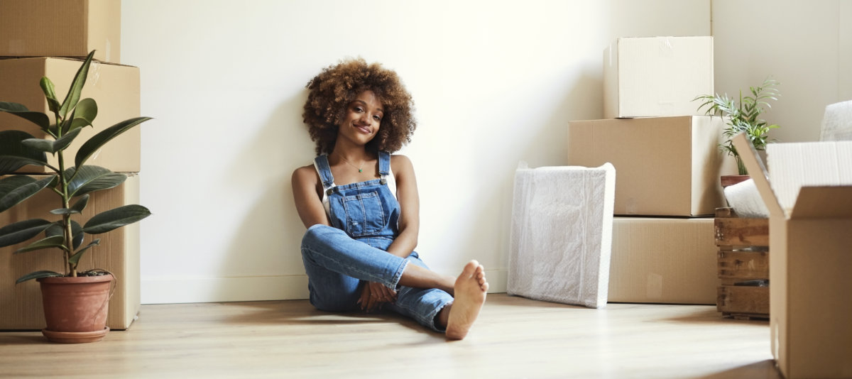 Woman sitting in her new apartment