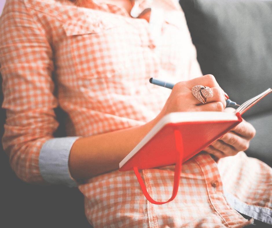 Woman writes in journal